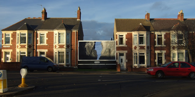 2012 Digital image. Design for site-specific billboard work exploring an exchange between two opposing landscapes connected by the sea.