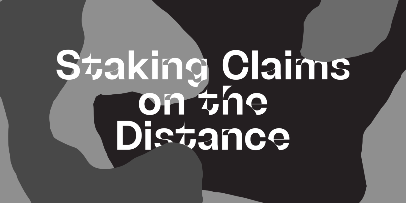 White writing saying Staking Claims on the Distance on a black and grey