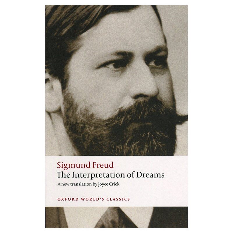 The front cover of 'Sigmund Freud, The Interpretation of Dreams'. Under the title in a beige banner reads 'A new translation by Joyce Crick, Oxford World's Classics'. Behind is a sepia photo of Sigmund Freud. He has a beard and is looking off into the distance.