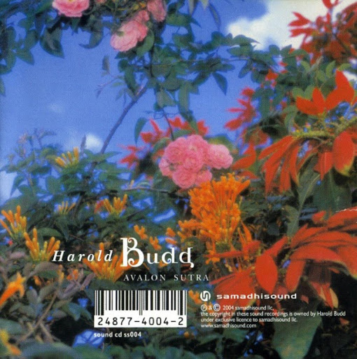 Back of an album cover which is an image of orange, pink and pink flowers in front of a blue sky with some clouds. The colour has been heightened. There is white writing and a white barcode at the bottom of the image. Writing reads 'Harold Budd, Avalon sutra, samadhisound'