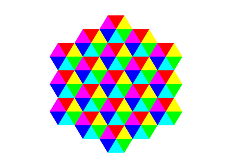 Graphic image of a geometric patterned shape made up of hexagons of red, yellow, fuscia, green, blue and turquoise triangles.