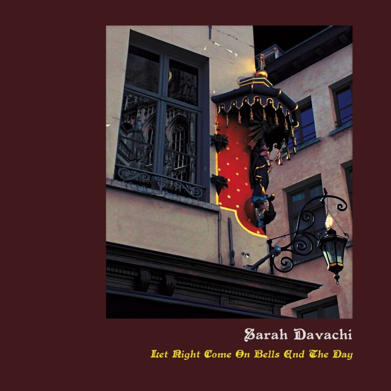 Photograph and writing in a maroon background. The photo is of the corner of a building in the evening. There is a black window and a lit up shrine of some sort above a street lamp. Writing is in white and yellow and reads 'Sarah Davachi, Iset Right Come On Bells End The Day'