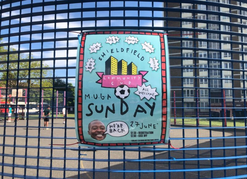 The poster for Shieldfield Cup #3 attached to a blue fence